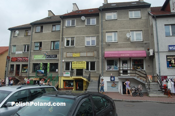 A row of shops with apartments above opposite the open-air market in Międzyrzecz, western Poland.